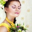 Girl with stylish makeup and flowers - Stock Photo