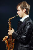 Young man with saxophone — Stok fotoğraf