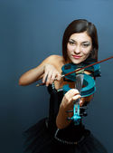 Girl with blue electric violin — Stock Photo