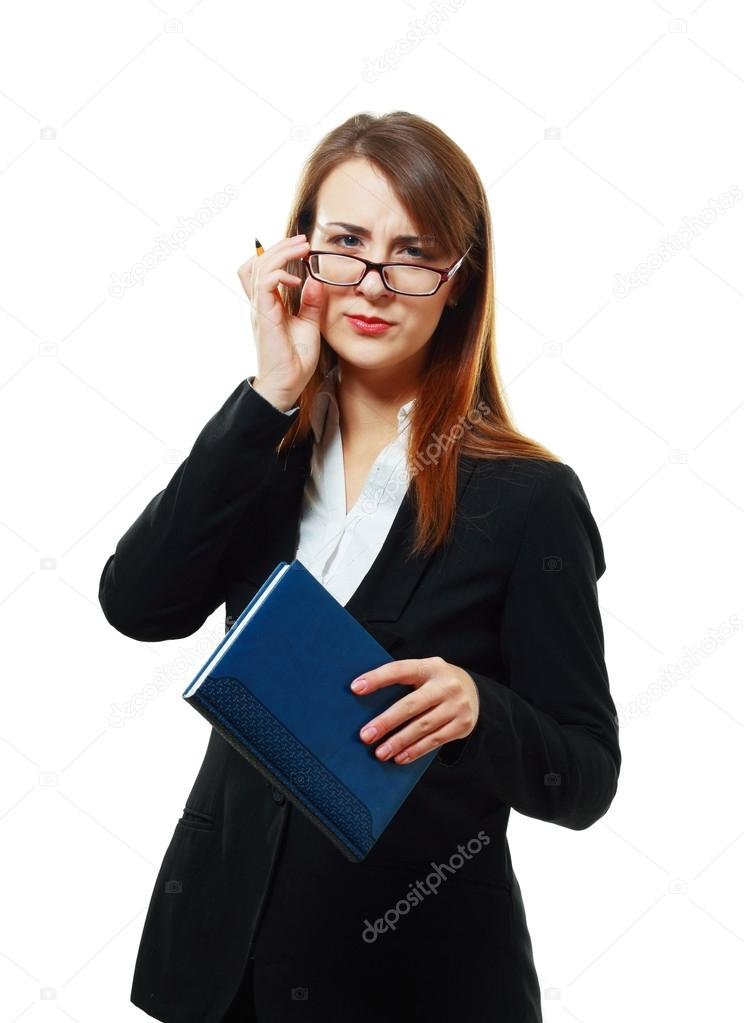 Suspicious business woman or teacher in glasses with book in her hands looking to the camera  distrustful — Stockfoto #18712585