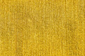 Texture of yellow jeans as a background — Stockfoto