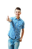 Handsome young man with thumbs up — Stock Photo