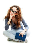 Bored student girl holding book — Stock Photo