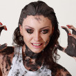 Woman with face and body covered in mud - Stock Photo