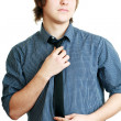 Young man adjusting his tie — Stock Photo
