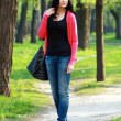 Brunette woman in the park — Stock Photo