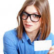 Woman holds out card — Foto de Stock