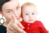 Mother with baby pointing — Stock Photo