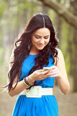 Girl texting on the phone — Stock Photo