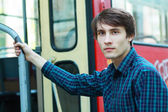 Man going to enter the city tram — Stock Photo