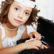 Beautiful little girl plays — Stock Photo