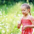 Royalty-Free Stock Photo: Girl have fun with dandelions