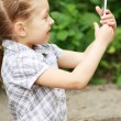 Little girl with mobile phone — Stock Photo