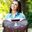 Young woman with old suitcase — Stock Photo