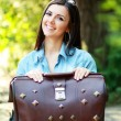 Young woman with old suitcase — Stock Photo #26084695