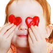 Little girl with two little red heart — Stockfoto