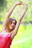 Woman stretching up — Stock Photo