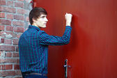 Young man knocking — Stock Photo