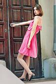 Woman trying to open door — Stock Photo