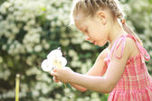 Girl have fun with dandelions — Stock Photo