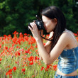 Girl in poppies field — Stock Photo #26600115
