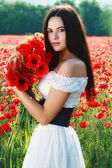 Girl in poppies field — Stock Photo