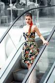 Lady standing on escalator — Stock Photo