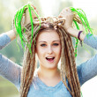 Stock Photo: Womwith dreads making face
