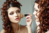 Woman directs a make-up — Stock Photo