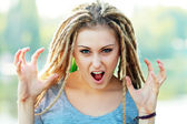 Woman with dreads making face — Stock Photo