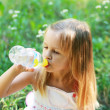Little girl drinks mineral water — Stock Photo #29150145
