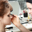Bride applying wedding make-up — Stock Photo #31246175