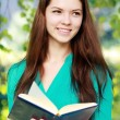 Teenage girl with book — Stock Photo #31246353