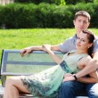 Couple in love relaxing in park — Stock Photo