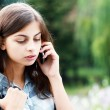 Teenage school girl calling — Stock Photo