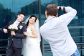 Photographer in action — Stock Photo