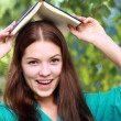 Teenage girl with book — Stock Photo