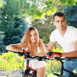 Couple with their bikes — Stock Photo