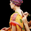 Henna applying on the back — Stock Photo #34303587