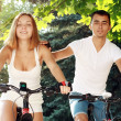 Young couple on their bikes — Stock Photo