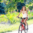 Girl is riding on a bicycle — Stock Photo