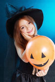 Girl in witch halloween costume — 图库照片