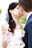 Young married couple kissing — Stock Photo