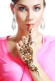 Woman face henna on hand — Stock Photo