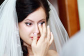 Beautiful bride tears — Stock Photo