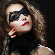 Woman in black mask — Stock Photo