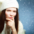 Brunette girl over blue snowy — Stock Photo
