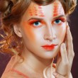 Stock Photo: Womwith orange artistic visage