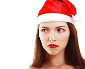 Dissatisfied girl in Santa's hat — Stock Photo