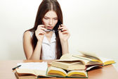 Student girl with books at the desk — Stock Photo